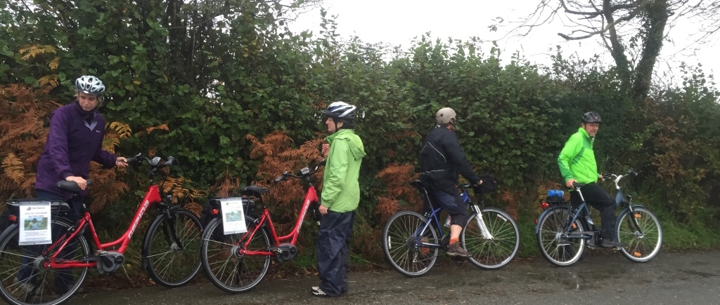 four bicyclists on a Devon country lane
